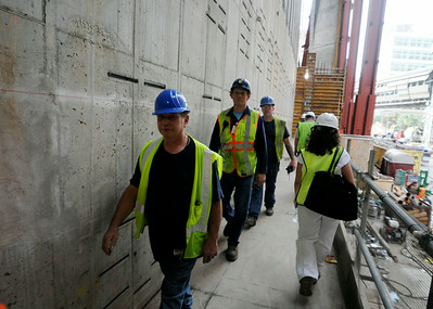 Construction workers walks along an outer corridor at One World Trade Center in September 2013. (Photo by Jackie Schear)